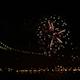 Firework at Night near Illuminated Bridge - VideoHive Item for Sale