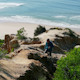 Man Climb on a Cliff Above the Ocean - VideoHive Item for Sale