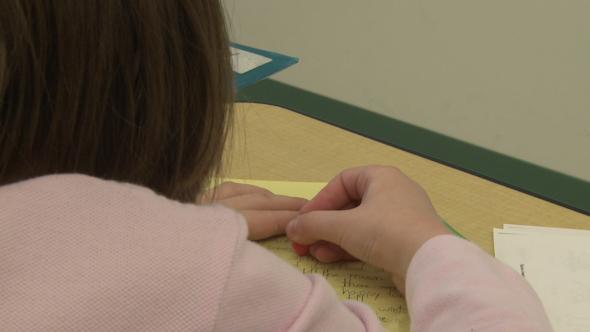 Grammar School Students Working On Papers In Classroom 5 Of 11