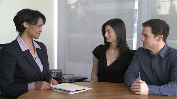 Young Couple Listens To Real Estate Agent 3 Of 3