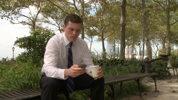 Businessman Sits On Bench Talking On Phone 1 Of 3