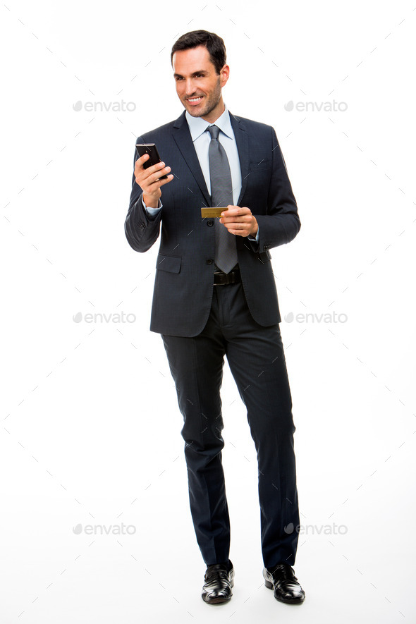 businessman holding mobile phone and credit card