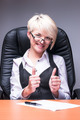 Attractive blonde smiling business lady shows thumb up - PhotoDune Item for Sale