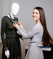 Young woman looking at necklace on mannequin in showroom - PhotoDune Item for Sale