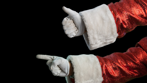 Santa s Hand Shows The Direction And Thumbs Up