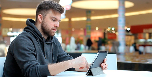 Man Working on a Tablet Screen is not Visible
