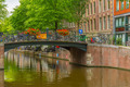 Amsterdam canal and bridge with bikes, Holland, Netherlands - PhotoDune Item for Sale