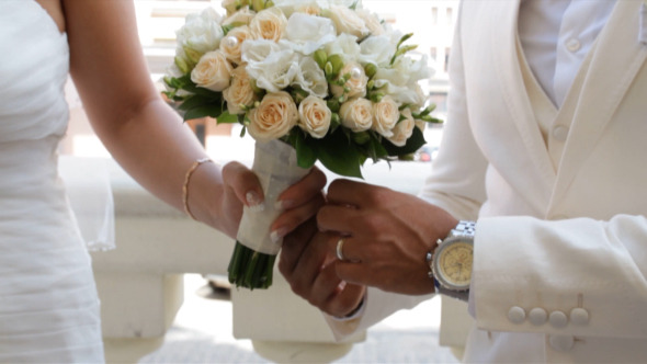 Wedding Bouquet in Hands of The Bride and Groom