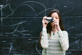 Young woman taking a photo with an old camera. - PhotoDune Item for Sale