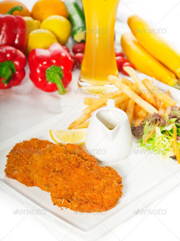 classic Milanese veal cutlets and vegetables - Stock Photo - Images
