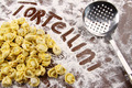 Fresh tortellini and utensil with flour on table - PhotoDune Item for Sale