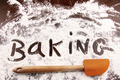 Word baking written in white flour on wooden table - PhotoDune Item for Sale