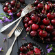 Fresh summer cherries and flowers in aluminum plates - PhotoDune Item for Sale
