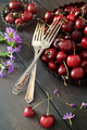 Cherries and flowers on old wood table - PhotoDune Item for Sale