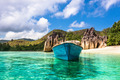 Old fishing boat on Tropical beach at Curieuse island Seychelles - PhotoDune Item for Sale