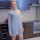Blond Woman In Gray Dress Standing At The Kitchen 1 - VideoHive Item for Sale