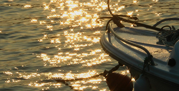 Fishing Boat and Sun Reflection on Sea