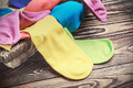 scattered multi-colored socks and laundry basket - PhotoDune Item for Sale