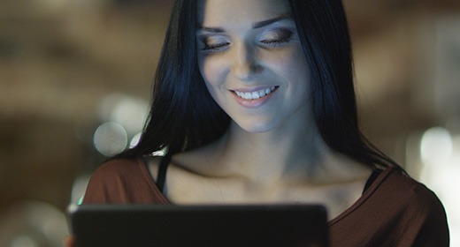 Charming Girl with Beautiful Smile Using Electronic Devices