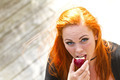 Red hair girl in pin-up style eating an apple - PhotoDune Item for Sale