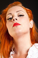 Red hair girl in pin-up style portrait shot in studio - PhotoDune Item for Sale
