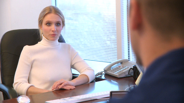 Professional Female Speaks With A Co-Worker 7 Of 12