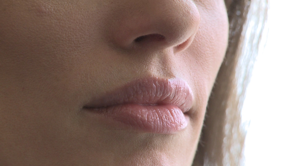 Closeup Of Woman's Mouth As She Converses 3 Of 3