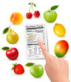Fresh fruit with a nutrition facts label and hand. - PhotoDune Item for Sale
