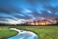 Long Exposue Sunset with Blurred Clouds over River Landscape - PhotoDune Item for Sale