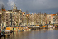 Canal houses and house boats in Amsterdam - PhotoDune Item for Sale
