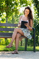 Girl on bench in park with ereader - PhotoDune Item for Sale
