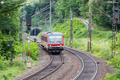 Train driving through woods near river Moselle in Germany - PhotoDune Item for Sale