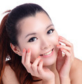Asian beauty skin care woman smiling touching her face - PhotoDune Item for Sale