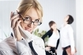 Young beautiful businesswoman calling by phone - PhotoDune Item for Sale