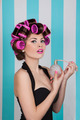retro pin up girl spraying perfume with hair rollers - PhotoDune Item for Sale