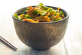 stir-fried yellow noodles with pork on wood table - PhotoDune Item for Sale