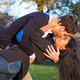 Man kissing passionatly his wife in park - PhotoDune Item for Sale