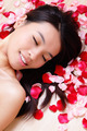 Asian beauty young Girl close her eyes and smile with rose background - PhotoDune Item for Sale