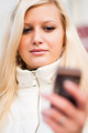 Attractive blonde woman with mobile phone - PhotoDune Item for Sale