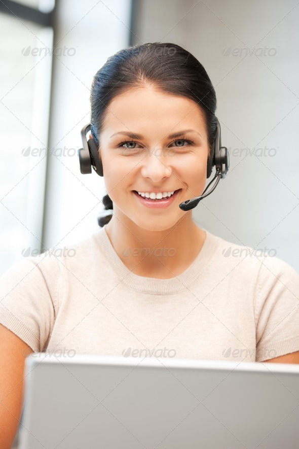 helpline operator with laptop computer - Stock Photo - Images