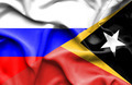 Waving flag of East Timor and Russia - PhotoDune Item for Sale