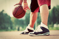 Young man on basketball court dribbling with bal - PhotoDune Item for Sale