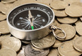 compass on a heap of coins - PhotoDune Item for Sale