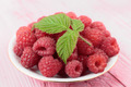 Raspberries in a bowl on a wooden table pink - PhotoDune Item for Sale