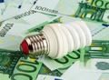 Energy saving light bulb on Euro banknotes - PhotoDune Item for Sale