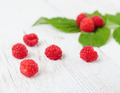 Raspberries on a wooden white table - PhotoDune Item for Sale