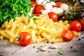 Ingredients for pasta: cherry tomatoes, mozzarella, fresh basil, fusilli, garlic and olive oil