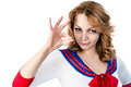 Attractive woman in sailor costume shows ok gesture - PhotoDune Item for Sale