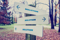 Signboard with the word Solution with arrows pointing in three d