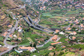 Aerial view of little villages and a highway in the mountains of Madeira Island - PhotoDune Item for Sale
